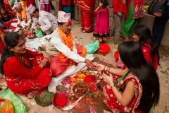 Women recieve blessings at Teej festival, Durbar Square, Kathman Royalty Free Stock Photography