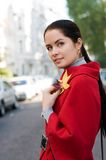 Women in red coat on the street Royalty Free Stock Photo