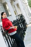 Women in red coat on the street Royalty Free Stock Photos