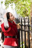 Women in red coat on the street Royalty Free Stock Images