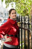 Women in red coat on the street Stock Photo