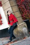 Women in red coat on the street Stock Image