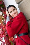 Women in red coat on the street Stock Photos