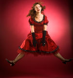 Woman in red dress jumping Stock Photo