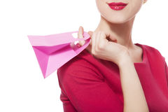 Women in red dress with little shopping bag Stock Images