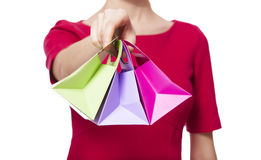 Women in red dress with little shopping bags Royalty Free Stock Image