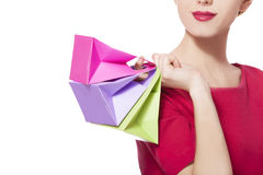 Women in red dress with little shopping bags Stock Photography