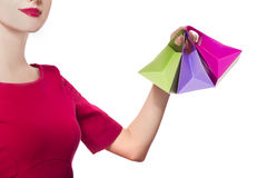Women in red dress with little shopping bags Stock Photo