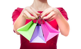 Women in red dress with little shopping bags Stock Images