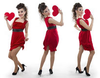 Women in a red dress shows the heart Stock Image