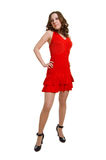 Women in red dress on a white Stock Photos