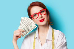 Women in red glasses with money Royalty Free Stock Images