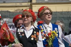 Women in red hats sing war song on Theater Square in Moscow. Royalty Free Stock Image