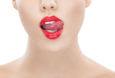 Women red lips with tongue out of mouth Stock Image