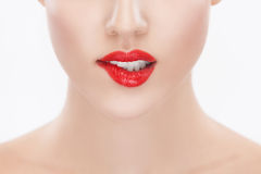 Women with red lipstick biting lip Royalty Free Stock Photography