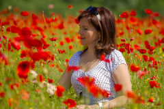 Women in red poppies Royalty Free Stock Images