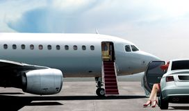 Women in red ready to boarding a private jet. Women in red getting ready to boarding a private jet Royalty Free Stock Photography