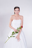 Women with red rose. Woman in wedding dress with red rose Royalty Free Stock Photos