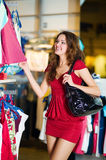 Women in red shopping Royalty Free Stock Image