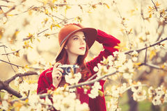 Women in red sweater and hat with camera Stock Photos