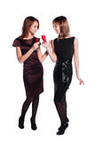 Two young fashion women with a red wine glasses Royalty Free Stock Photos
