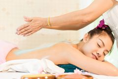 Women is relax with Therapist putting salt scrub Royalty Free Stock Images