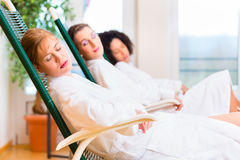 Women in relaxation room of wellness spa. Friends relaxing and sleeping in relaxation room on lounger of wellness spa Stock Photos