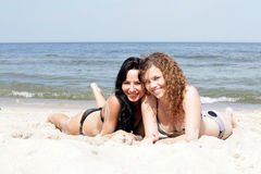 Women relaxing on the beach Royalty Free Stock Images