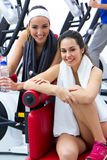 Women relaxing in the gym after making exercise Royalty Free Stock Images