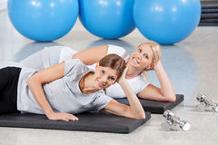 Women relaxing on gym mats Royalty Free Stock Images
