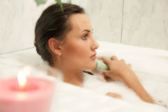Women relaxing in her bath Royalty Free Stock Photography