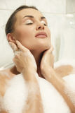 Women relaxing in her bath Royalty Free Stock Photos