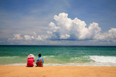 Women relaxing on Karon beach in Phuket Royalty Free Stock Photos