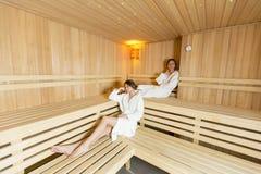 Women relaxing in the sauna Stock Image