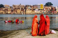 Women and religious rituals in the Ganges. The religious sentiment defines Varanasi, a sacred city for Hindus. The early hours of the morning are for prayer and stock photo