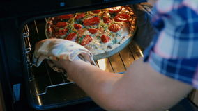 Women remove freshly baked French Quiche from oven. stock footage