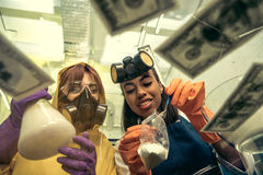 Women in respirators preparing drugs in laboratory, drugs concept Royalty Free Stock Photo