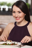Women at restaurant. Portrait of beautiful middle-aged women eat Stock Photo