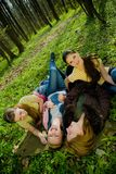 Women resting. Young women resting in forest, portrait, elevated view royalty free stock images