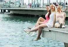 Women resting on esplanade. Portrait of three  smiling young women resting together on esplanade in city Stock Image