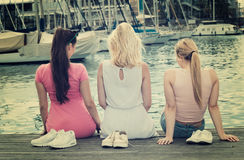 Women resting on esplanade. Three cheerful young women resting together on esplanade in european city Royalty Free Stock Photography