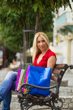 Women resting after shopping on the bench Royalty Free Stock Photos