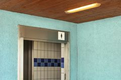 Women restroom near swimming pool, entrance with ladies toilet i stock photography