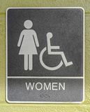 Women restroom sign posted on a green wall royalty free stock image