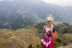Chinese woman with garb in rice terraces Lo Stock Photo