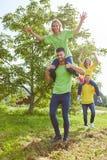 Women ride piggyback in teambuilding workshop Stock Photo