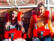 Women riding in the amusement park Royalty Free Stock Image