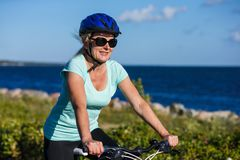 Women riding bicycle Stock Images
