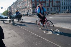 Women riding a bicycle on a bike path. Copenhagen Denmark - September 26. 2011: Women riding a bicycle on a bike path Royalty Free Stock Photos