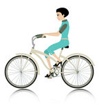 Women riding a bicycle. Stock Image